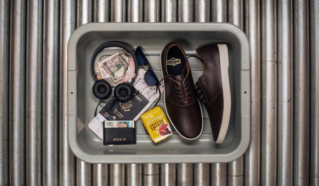austyn_airport_shoes_in_bin