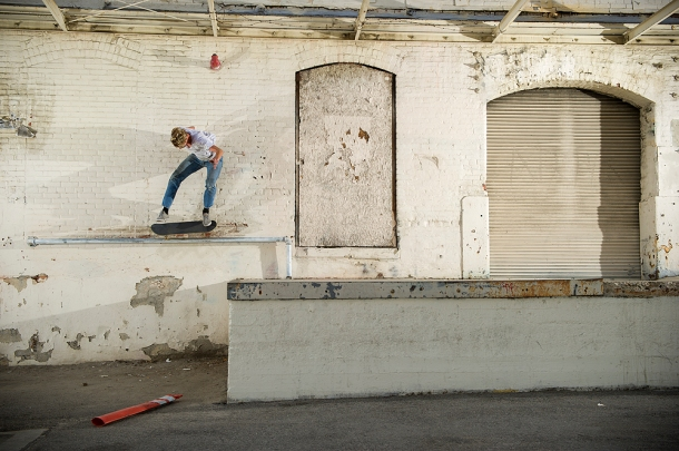 Johan Stuckey_kickflip 5050_loading dock rail Chinatown(sized)